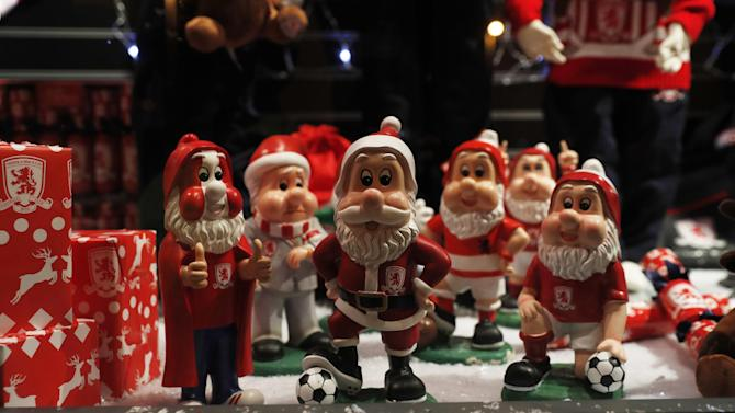 General view of model Santa's outside the stadium before the match