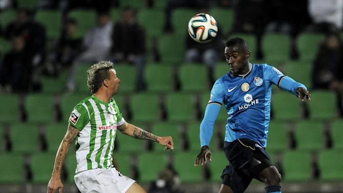 FC Porto's Jackson Martinez, right, from Colombia heads the ball past Rio Ave's Lionn Lucena, from Brazil, in a Portuguese League soccer match, in Vila do Conde, northern Portugal, Sunday, Dec. 15, 2013