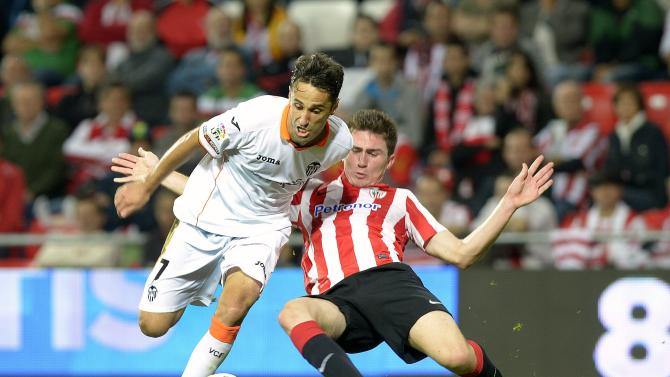 Valencia's Oliveira challenges Athletic Bilbao's Laporte during their Spanish first division soccer match in Bilbao