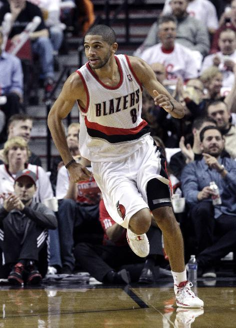 Portland Trail Blazers forward Nicolas Batum, from France, heads downcourt during the second half of an NBA basketball game against the San Antonio Spurs in Portland, Ore., Saturday, Nov. 2, 2013. Batum scored a triple-double as the Trail Blazers defeated the Spurs 115-105
