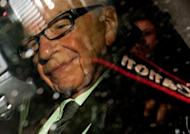 Rupert Murdoch said he did not investigate Rebekah Brooks' admission that the News of the World had paid police officers for information because he was unaware of her statement