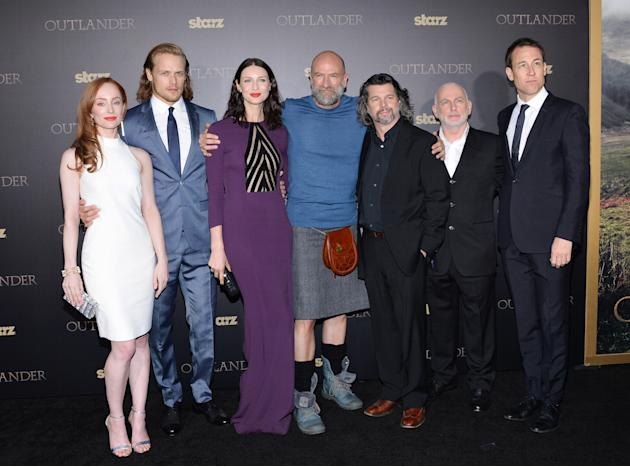 "Actors Lotte Verbeek, from left, Sam Heughan, Caitriona Balfe, Graham McTavish, executive producer Ronald Moore, Gary Lewis and Tobias Menzies attends the STARZ mid-season premiere of ""Outlander&"