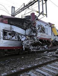 In this image provided by the Luxembourg Police Grand Ducale, the wreckage of a passenger train and a freight train after they collided in Bettemberg, Luxembourg on Tuesday, Feb. 14, 2017. The collision left one person dead and at least four injured. (Luxembourg Police Grand Ducale via AP)