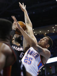 Miami Heat forward LeBron James (6) is fouled by Oklahoma City Thunder guard Thabo Sefolosha (25) in the second quarter of an NBA basketball game in Oklahoma City, Thursday, Feb. 20, 2014. (AP Photo/Sue Ogrocki)