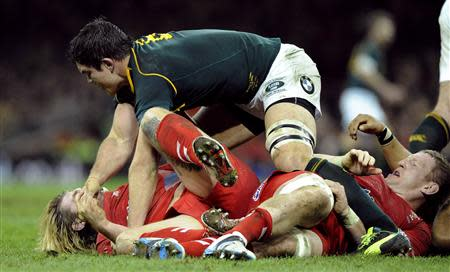 South Africa's Louw scuffles with Wales' Hibbard during their international rugby union match in Cardiff