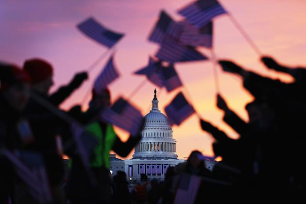 American flags are waved as people gather near the U.S. Capitol in Washington for the inauguration (Joe Raedle/Getty Images)