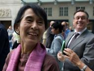 Myanmar democracy icon Aung San Suu Kyi leaves after meeting staff at BBC Broadcasting House in central London. Suu Kyi began a bittersweet return to Britain on Tuesday during which she will be showered with honours and have an emotional family reunion after nearly a quarter of a century in Myanmar