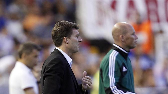 Swansea City's manager Michael Laudrup from Denmark gesture during their Europa  League Group A soccer match against Valencia  at the Mestalla stadium in Valencia, Spain, Thursday , Sept. 19, 2013