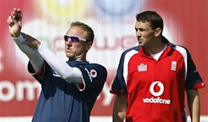 England's new bowling coach Donald speaks to bowler Harmison during practice session at Old Trafford in Manchester