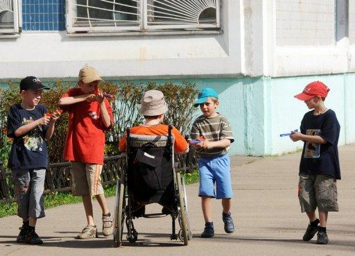 Children play on in an orphanage in Moscow May 12, 2010. The Russian parliament will vote this week on a bill banning adoption of Russian children by Americans, in retaliation to the Magnitsky Act passed by the United States last week, lawmakers said.