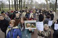 People gather at the Parc de la Tete d'Or zoo in Lyon on January 6, 2013, to show their support for Baby and Nepal, two elephants suffering from tuberculosis. French President Francois Hollande will not intervene in the case of two ailing zoo elephants whose death sentence led Brigitte Bardot to threaten to go into exile in Russia, according to his office