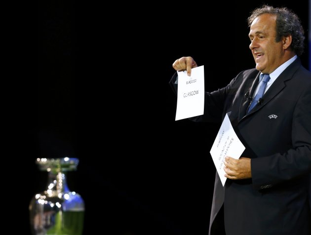 UEFA President Michel Platini shows the name of Glasgow, one of the 13 cities which will host matches at the Euro 2020 tournament to be played across the continent, during a ceremony in Geneva September 19, 2014.  REUTERS/Denis Balibouse (SWITZERLAND  - Tags: SOCCER SPORT)