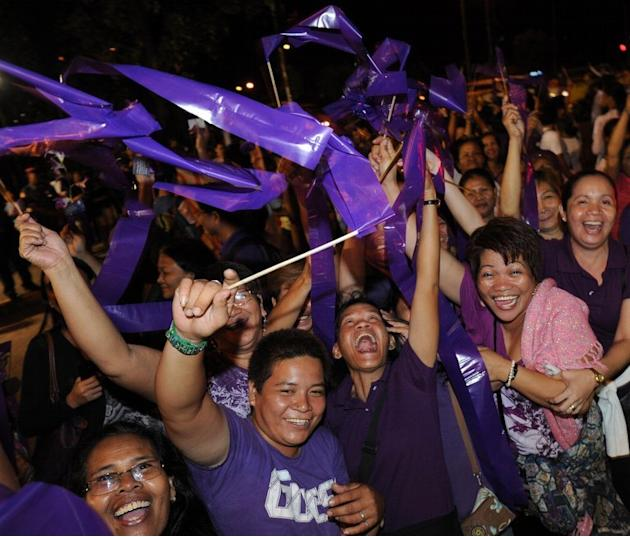 People celebrate after legislators pass a landmark birth control bill in Manila on December 17, 2012