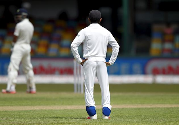 Sri Lanka's Silva is seen wearing ankle guards on the second day of their third and final test cricket match against India in Colombo