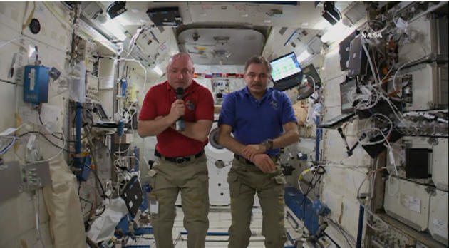 This video screen grab taken from NASA, American astronaut Scott Kelly and Russian cosmonaut Mikhail Kornienko are interviewed at International Space Station on Wednesday, April 29, 2015.  Kelly and K