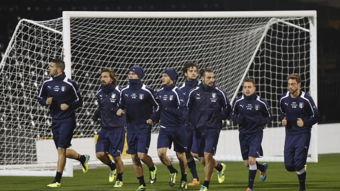 Italy's players run during a training session at Craven Cottage in London, Sunday, Nov. 17, 2013. Italy is to play a friendly soccer match against Nigeria on Monday Nov. 18 at Craven Cottage in London