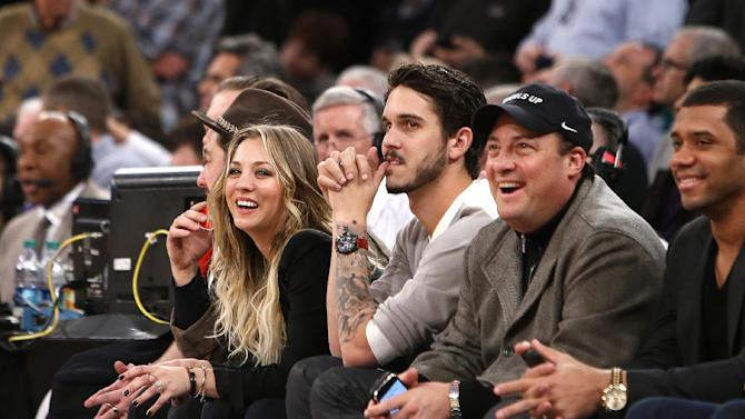 From left, actress Kaley Kuoco, her husband, tennis player Ryan Sweeting, Wheels Up CEO Kenny Dichter and Seattle Seahawks quarterback Russell Wilson attend an NBA basketball game between the Dallas Mavericks and the New York Knicks, Monday, Feb. 24, 2014, in New York. Dallas won 110-108