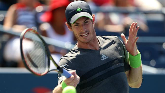 US Open - Wounded Murray battles into second round
