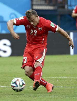 Shaqiri's hat trick puts Swiss into 2nd round