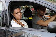 France international footballer Samir Nasri arrives in a car at the French Football Federation headquarters, where he was handed a three-match ban from the French national team following an investigation into his behaviour during Euro 2012