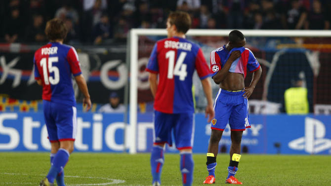 Basel's players react after Champions League soccer match against Schalke 04 in Basel