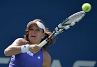 Agnieszka Radwanska of Poland hits a forehand against Jelena Jankovic of Serbia during their 2012 US Open women's singles match at the USTA Billie Jean King National Tennis Center in New York. Radwanska won 6-3, 7-5