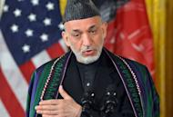 """Afghan President Hamid Karzai answers a question during a press conference at the White House on January 11, 2013. US President Barack Obama has said the US goal in Afghanistan is """"within reach"""" as he vowed to move ahead with a timetable to end the 11-year-old military campaign and focus on a broad domestic agenda"""