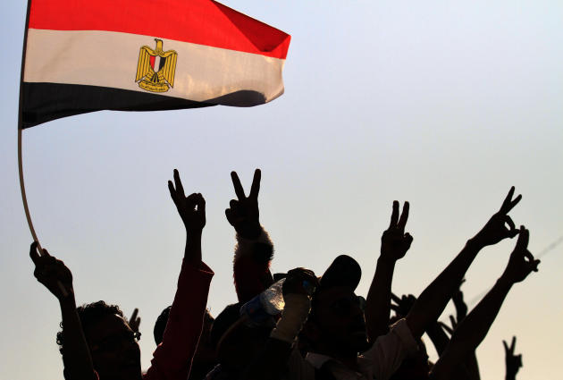 """Protesters gesture,  as they demonstrate at Tahrir Square in Cairo, Egypt, Tuesday, July 12, 2011. Egypt's military rulers have sternly warned protesters against """"harming public interests"""" as demonstr"""