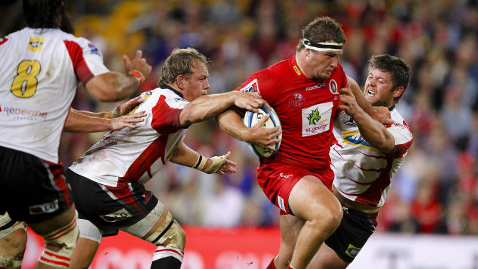 Queensland Reds prop James Slipper (C) is tackled by Golden Lions players during their Super 15 rugby union match at Suncorp Stadium in Brisbane on May 19, 2012.  IMAGE STRICTLY RESTRICTED TO EDITORIAL USE - STRICTLY NO COMMERCIAL USE AFP PHOTO / Patrick HamiltonPATRICK HAMILTON/AFP/GettyImages