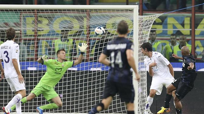 Inter Milan Brazilian defender Cicero Jonathan, right, scores a goal during the Serie A soccer match between Inter Milan and Fiorentina at the San Siro stadium in Milan, Italy, Thursday, Sept. 26, 2013