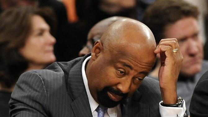 New York Knicks' head coach Mike Woodson reacts to his team as fall behind the Boston Celtics during the second half of an NBA basketball game on Sunday, Dec. 8, 2013, in New York. The Celtics won 114-73