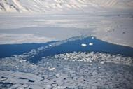 File photo shows ice melting next to the village of Ny-Aalesund in the Arctic. The sea ice in the Arctic Ocean has melted to its smallest point ever in a milestone that may show that worst-case forecasts on climate change are coming true, US scientists said