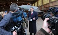 Britain's Defence Secretary Philip Hammond talks to the media in front of a Royal Air Force Typhoon fighter jet at RAF Waddington in February. Hammond said he had finally balanced his department's books, in an interview out Sunday, following a week in which he made a U-turn on purchasing jets, to the annoyance of France