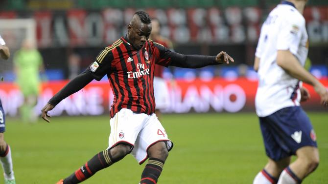 AC Milan's Mario Balotelli shoots to score against Bologna during their Italian Serie A soccer match in Milan