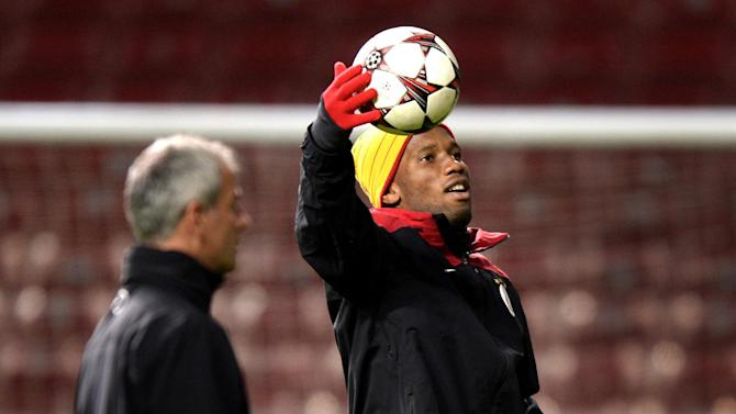 Galatasaray's Didier Drogba, right, grabs a ball during a training session prior to their Champions League soccer match on Tuesday against FC Copenhagen at Parken Stadium in Copenhagen, Denmark, Monday, Nov. 4, 2013