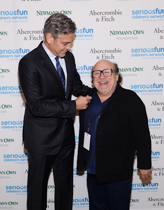"Actors George Clooney, left, and Danny DeVito attend ""An Evening of SeriousFun Celebrating the Legacy of Paul Newman,"" hosted by the SeriousFun Children's Network at Avery Fisher Hall on"