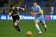 Lazio's defender from Romania Stefan Radu (R) vies for the ball with AC Milan's forward from Spain Fernandez Suso during the Italian Serie A football match Lazio vs Milan on February 13, 2017, at Rome's Olympic stadium