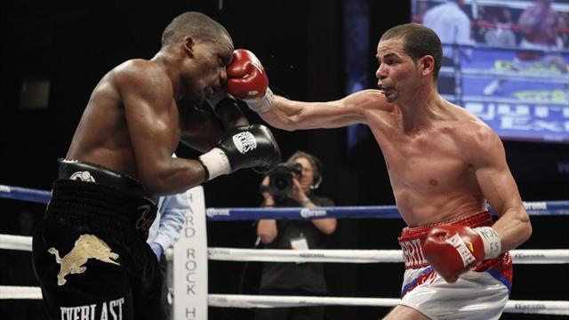 Boxing - Abril tames Bogere to defend WBA lightweight belt