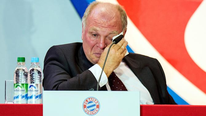 FILE - A file photo dated Nov. 13, 2013 shows Uli Hoeness, the president of German soccer club FC Bayern Munich, crying at the annual general meeting of Bayern Munich in Munich, Germany. Hoeness has been sentenced to 3 years and 6 months in prison on Thursday in a tax evasion trial. The 62-year-old Hoeness was charged with dodging 3.5 million euros (US $4.85 million) in taxes, but when his trial opened Monday he admitted avoiding 15 million euros more. Then it came out through an examination of documents he provided to investigators shortly before the trial that he owed 27.2 million euros in total - a number Hoeness did not dispute. (AP Photo/dpa,,Marc Mueller,File)