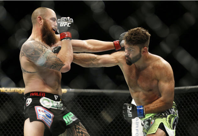 Andrei Arlovski, right and Travis Browne trade blows during their heavyweight mixed martial arts bout at UFC 187 on Saturday, May 23, 2015, in Las Vegas. (AP Photo/John Locher)