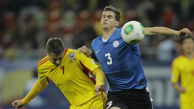 Mikk Reintam, right, of Estonia and Gheorghe Grozav, left, of Romania clash during their World Cup Group D qualifying soccer match at the National Arena stadium in Bucharest, Romania, Tuesday, Oct. 15, 2013