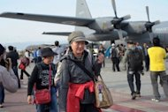 Japanese tourists walk upon their arrival at Chaklala Airbase in Rawalpindi after evacuation by the Pakistan Air force from Gilgit. Pakistan on Sunday evacuated 120 foreigners, mostly Japanese tourists who had been stranded in the north of the country following sectarian clashes that killed at least 14 people
