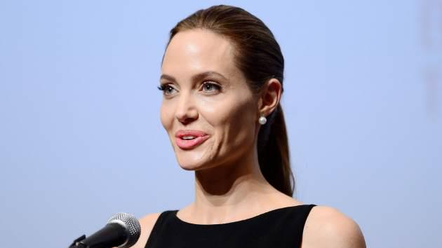 Angelina Jolie makes a speech before a screening of the movie 'In the Land of Blood and Honey' which she directed, at United Nations University in Tokyo on July 29, 2013 -- Getty Premium
