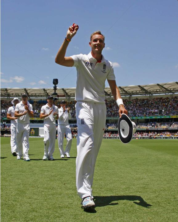 England's Broad shows the ball to fans after taking six wickets during the second day's play of the first Ashes cricket test match against Australia in Brisbane
