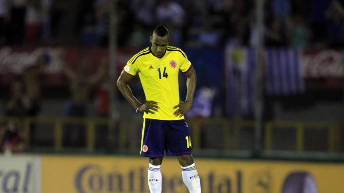 Colombia's Perea reacts after his team's defeat to Uruguay during their 2014 World Cup qualifying soccer match in Montevideo