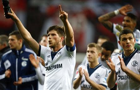 Schalke 04's Huntelaar celebrates after winning Bayer Leverkusen in their German first division Bundesliga soccer match in Leverkusen