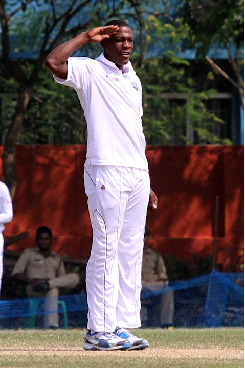 West Indies player S Cottrel celebrates a wicket during day three of practice match between West Indies and Uttar Pradesh Cricket Association XI at the Jadavpur University Ground in Kolkata on Nov. 2,
