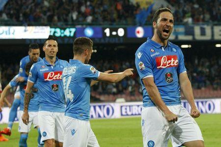 Napoli's Higuain celebrates after scoring against AC Milan during their Italian Serie A soccer match at the San Paolo stadium in Naples