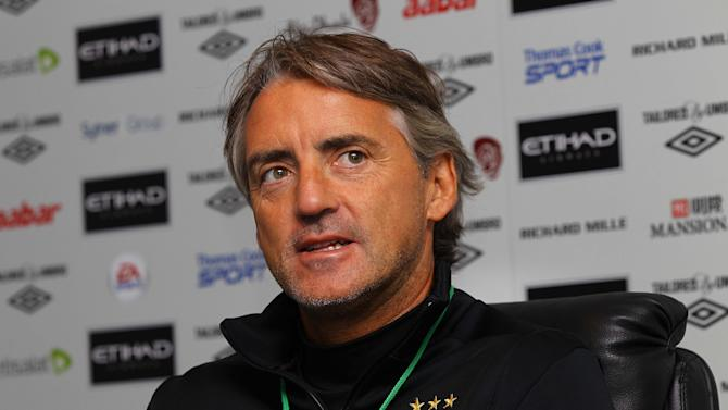 Roberto Mancini, pictured, insists Robin Van Persie's arrival makes Manchester United favourites for the title