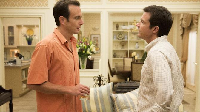 "This undated publicity photo released by Netflix shows Will Arnett, left, and Jason Bateman in a scene from ""Arrested Development,"" premiering May 26, 2013 on Netflix. The subscription service announced the premiere date Thursday, April 4, saying that all 15 episodes of the comedy series will post at once. The Mitchell Hurwitz sitcom starring Jason Bateman was canceled by Fox in 2006 after three seasons. (AP Photo/Netflix, Michael Yarish)"